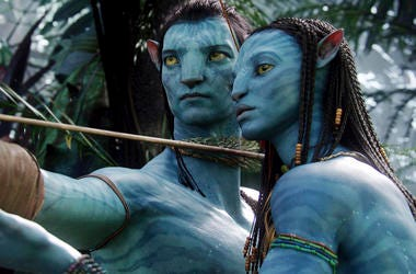 "This image released by 20th Century Fox shows the characters Neytiri, right, and Jake in a scene from the 2009 movie ""Avatar."" (AP Photo/20th Century Fox, File)"