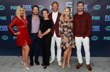 "Tori Spelling, from left, Jason Priestley, Gabrielle Carteris, Ian Ziering, Jennie Garth and Brian Austin Green, from the cast of ""BH90210,"" attend the FOX 2019 Upfront party at Wollman Rink in Central Park on Monday, May 13, 2019, in New York. (Photo by"