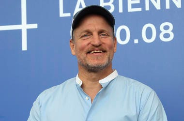 "In this Sept. 4, 2017, file photo, actor Woody Harrelson poses for photographers at the photo call for the film ""Three Billboards Outside Ebbing, Missouri"" during the 74th edition of the Venice Film Festival in Venice, Italy. (Photo by Joel Ryan/Invision/"