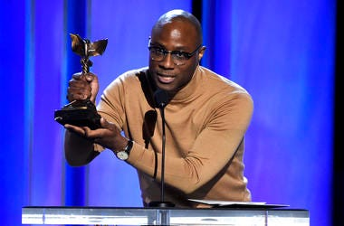 """In a Saturday, Feb. 23, 2019 file photo, Barry Jenkins accepts the award for best director for """"If Beale Street Could Talk"""" at the 34th Film Independent Spirit Awards, in Santa Monica, California.  (Photo by Chris Pizzello/Invision/AP, File)"""
