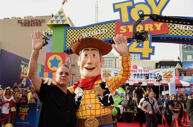 """Tom Hanks, left, poses with his character Woody as he arrives at the world premiere of """"Toy Story 4"""" on Tuesday, June 11, 2019, at the El Capitan in Los Angeles. (Photo by Chris Pizzello/Invision/AP)"""