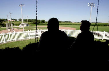 "In this July 11, 2007, file photo, New Mexico Gov. Bill Richardson, left, at the time a candidate for the Democratic presidential nomination, sits on the front porch of the house at the ""Field of Dreams"" movie site during a campaign stop in Dyersville, Io"