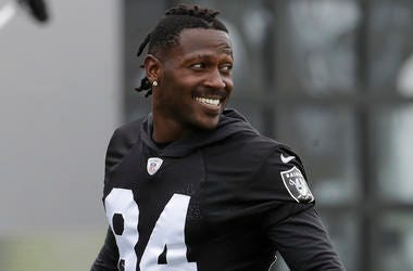 In this Aug. 20, 2019 file photo, Oakland Raiders' Antonio Brown smiles before stretching during NFL football practice in Alameda, Calif. Brown was released by the Raiders, Saturday, Sept. 7, 2019. (AP Photo/Jeff Chiu, File)
