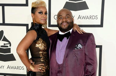 This Jan. 26, 2014 file photo shows songwriter LaShawn Daniels, right, and his wife April Daniels at the 56th annual Grammy Awards in Los Angeles. (Photo by Jordan Strauss/Invision/AP, File)