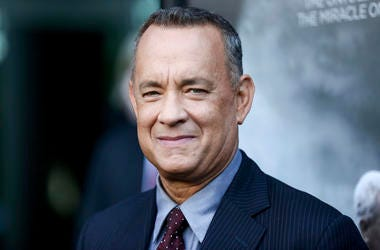 """In this Sept. 8, 2016 file photo, Tom Hanks arrives at the premiere of """"Sully"""" in Los Angeles. (Photo by Rich Fury/Invision/AP, File)"""