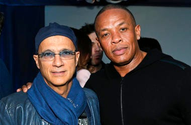 This Feb. 10, 2013 file photo shows music industry entrepreneur Jimmy Iovine, left, and hip-hop mogul Dr. Dre at a Grammy Party in Los Angeles. (Photo by Todd Williamson/Invision/AP, File)