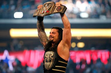 In this April 3, 2016, file photo, Roman Reigns holds up the championship belt after defeating Triple H during WrestleMania 32 at AT&T Stadium in Arlington, Texas. (Jae S. Lee/The Dallas Morning News via AP, File)/The Dallas Morning News via AP)