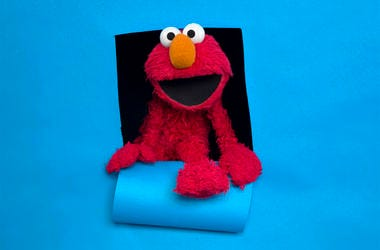 """In this Jan. 24, 2011, file photo, Elmo of the film """"Being Elmo"""" poses for a portrait in the Fender Music Lodge during the 2011 Sundance Film Festival in Park City, Utah. (AP Photo/Victoria Will, File)"""
