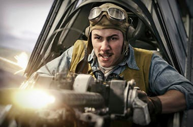 """This image released by Lionsgate shows Nick Jonas in a scene from """"Midway."""" (Reiner Bajo/Lionsgate via AP)"""