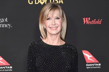 In this Jan. 27, 2018 file photo, Olivia Newton-John attends the 2018 G'Day USA Los Angeles Gala at the InterContinental Hotel Los Angeles. (Photo by Richard Shotwell/Invision/AP, File)