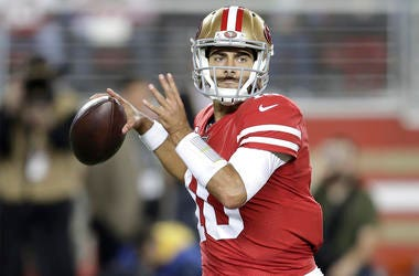 San Francisco 49ers quarterback Jimmy Garoppolo (10) passes against the Green Bay Packers during the first half of an NFL football game in Santa Clara, Calif., Sunday, Nov. 24, 2019. (AP Photo/Ben Margot)