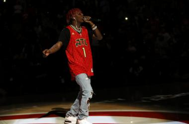 Lil Yachty performs at halftime of a game between the Atlanta Hawks and Washington Wizards at Philips Arena.