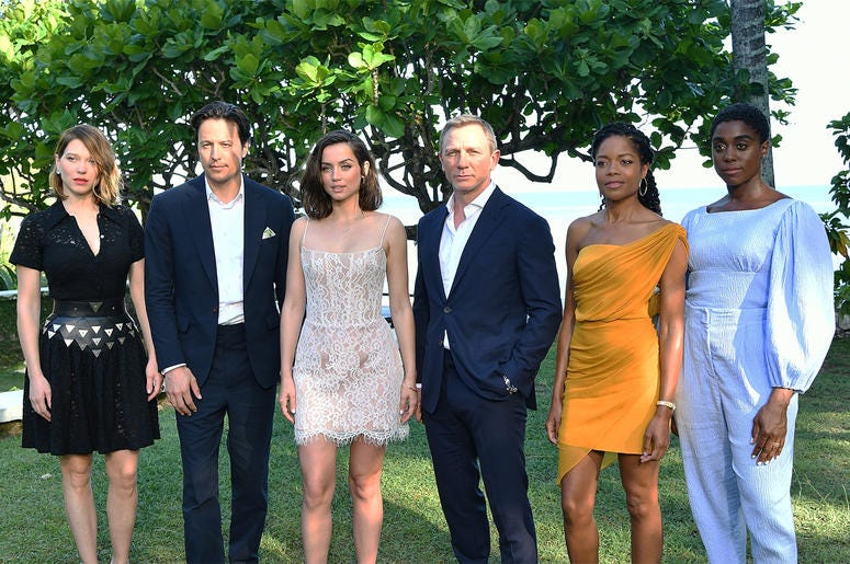 "MONTEGO BAY, JAMAICA - APRIL 25: (L-R) Cast member Lea Seydoux, director Cary Joji Fukunaga, cast members Ana de Armas, Daniel Craig, Naomie Harris and Lashana Lynch attend the ""Bond 25"" film launch at Ian Fleming's Home 'GoldenEye' on April 25, 2019 in M"