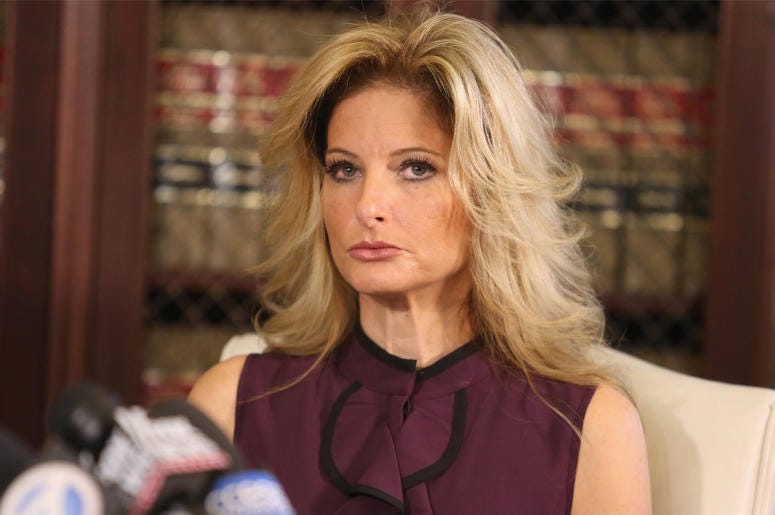 """LOS ANGELES, CA - OCTOBER 14: Summer Zervos, a former candidate on """"The Apprentice"""" season five, who is accusing Donald Trump of inappropriate sexual conduct, speaks to the press with her attorney Gloria Allred October 14, 2016 in Los Angeles, California."""