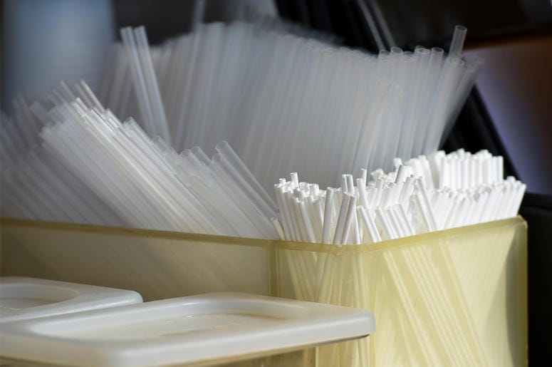 Straws in a plastic container