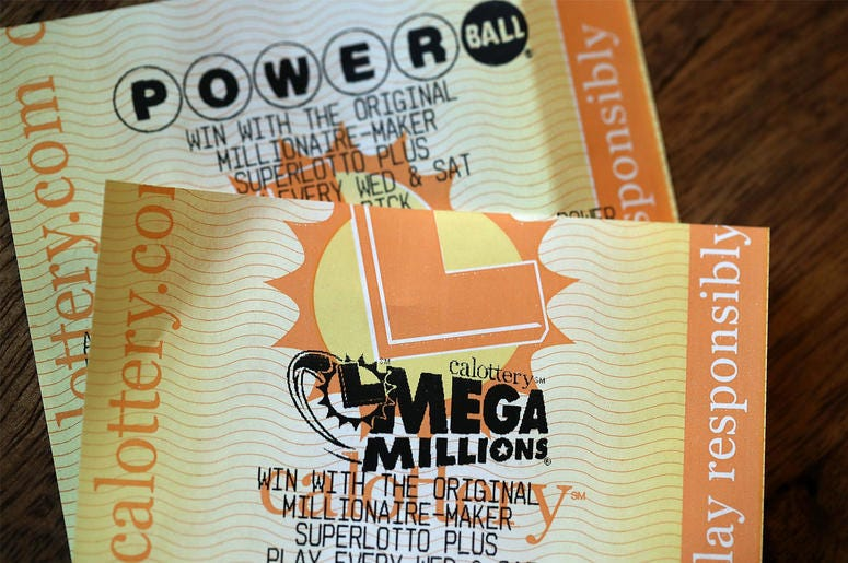 SAN ANSELMO, CA - JANUARY 03: Powerball and Mega Millions lottery tickets are displayed on January 3, 2018 in San Anselmo, California. The Powerball jackpot and Mega Millions jackpots are both over $400 million at the same time for the first time. The Meg