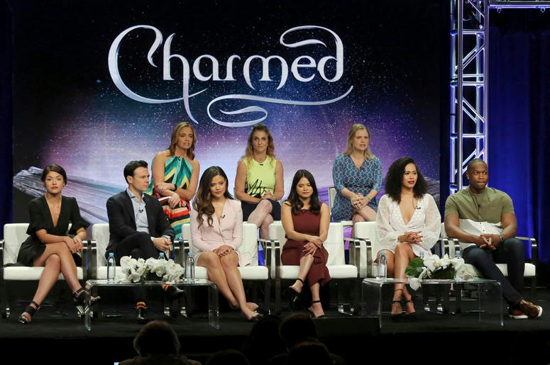 """Executive producers Jessica O'Toole, from back row left, Jennie Snyder Urman, Amy Rardin, and from front row left, Ellen Tamaki, Rupert Evans, Sarah Jeffery, Melonie Diaz, Madeleine Mantock and Ser'Darius Blain participate in the """"Charmed"""" panel during th"""