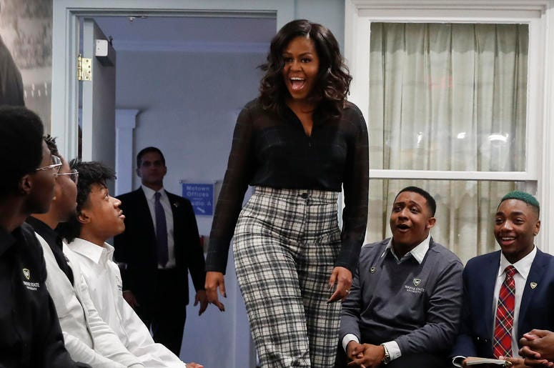Former First Lady Michelle Obama surprises students from Wayne State University during a discussion at the Motown Museum in Detroit, Tuesday, Dec. 11, 2018. (AP Photo/Paul Sancya)