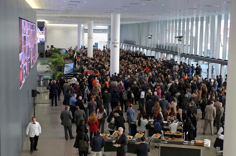 People listen to a number of speeches during the Moscone Center expansion opening Thursday, Jan. 3, 2019, in San Francisco. Completion of the $550 million expansion was celebrated by city officials, tourism industry leaders and neighborhood stakeholders.