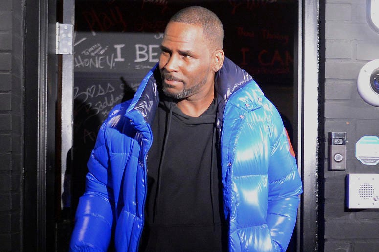 Musician R. Kelly leaves his Chicago studio on his way to surrender to police Friday night, Feb. 22, 2019. R&B star Kelly arrived Friday night at a Chicago police precinct, hours after authorities announced multiple charges of aggravated sexual abuse invo