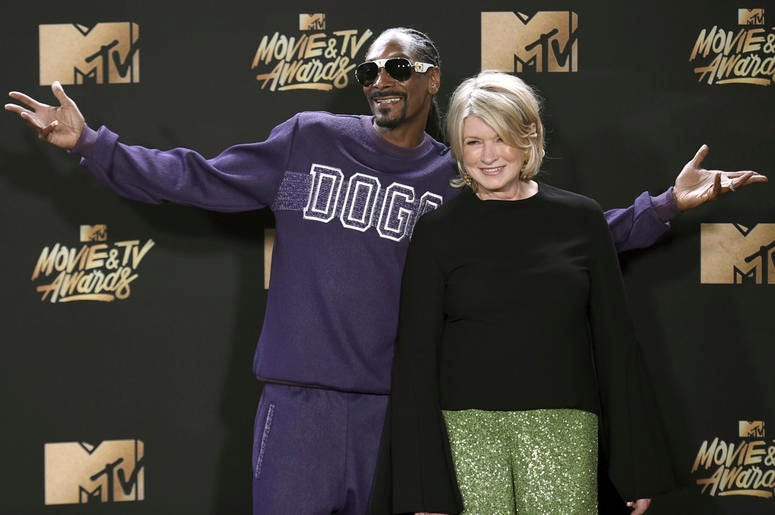 In this May 7, 2017 file photo, Snoop Dogg, left, and Martha Stewart pose in the press room at the MTV Movie and TV Awards in Los Angeles. The domestic diva who brought us hemp yarn is now partnering with Canada's Canopy Growth Corp. to develop new produc