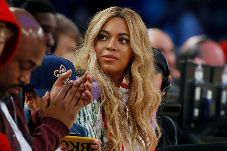 In this Feb. 19, 2017. file photo, Beyonce sits at court side during the second half of the NBA All-Star basketball game in New Orleans.  (AP Photo/Max Becherer, File)