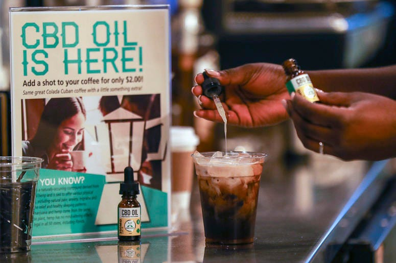 In this Jan. 4, 2018, file photo, a worker adds cannabidiol (CBD) to a drink at a coffee shop in Fort Lauderdale, Fla. (Jennifer Lett/South Florida Sun-Sentinel via AP, File)