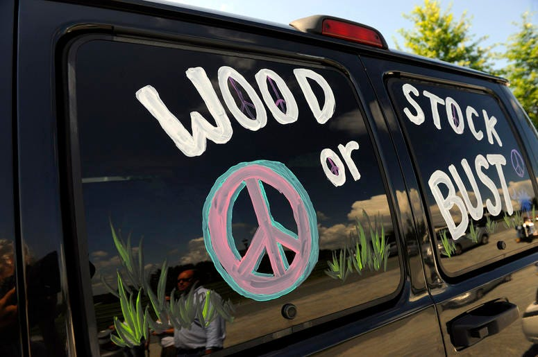 "This Aug. 14, 2009 file photo shows a van decorated with ""Woodstock or Bust"" at the original Woodstock Festival site in Bethel, N.Y. (AP Photo/Stephen Chernin, File)"