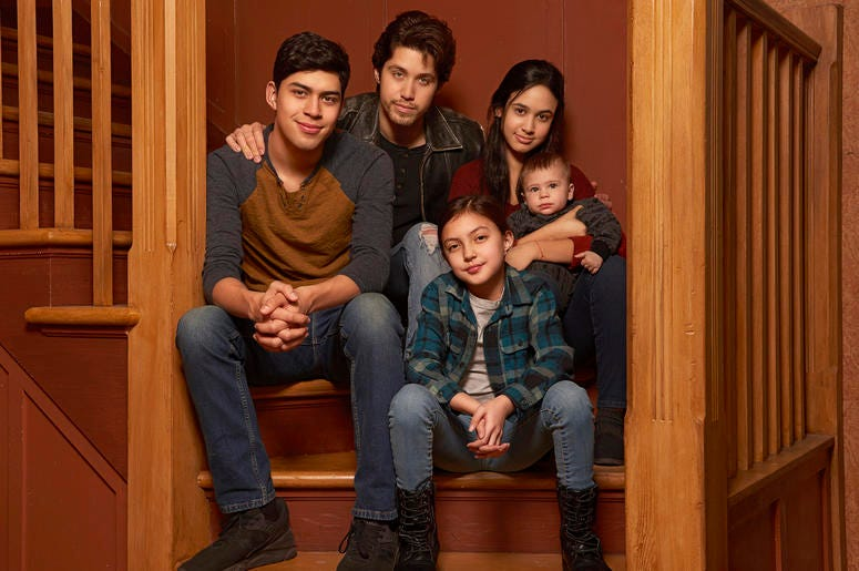 "This image released by Freeform shows the cast of ""Party of Five,"" Niko Guardado as Beto Buendia, left, Brandon Larracuente as Emilio Buendia, Elle Paris Legaspi as Valentina Buendia, foreground right, and Emily Tosta as Lucia Buendia."