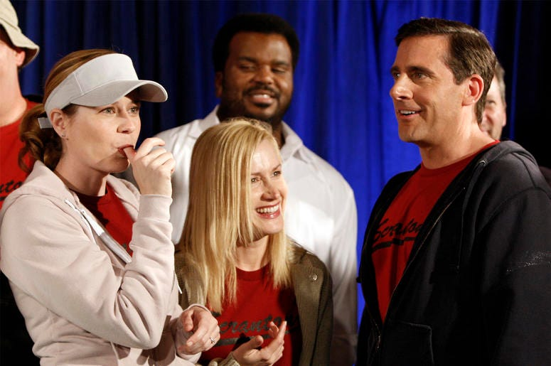 """In this April 14, 2009, file photo cast members, from left, Jenna Fischer, Angela Kinsey, Craig Robinson, and Steve Carell are seen after cutting a cake celebrating the 100th episode of the television show """"The Office"""" in Malibu, California. (AP Photo/Mat"""