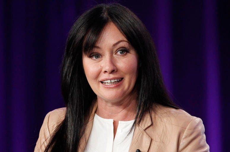 "In this Jan. 14, 2012, file photo, Shannen Doherty participates in a panel for the television show ""Shannen Says"" on WE tv during the AMC Networks portion of the Television Critics Association Winter Press Tour in Pasadena, California. (AP Photo/Danny Mol"