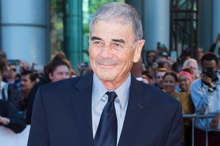"""In this Sept. 12, 2018 file photo, actor Robert Forster poses for photographs on the red carpet for the new movie """"What They Had"""" during the 2018 Toronto International Film Festival in Toronto. (Nathan Denette/The Canadian Press via AP, File)"""
