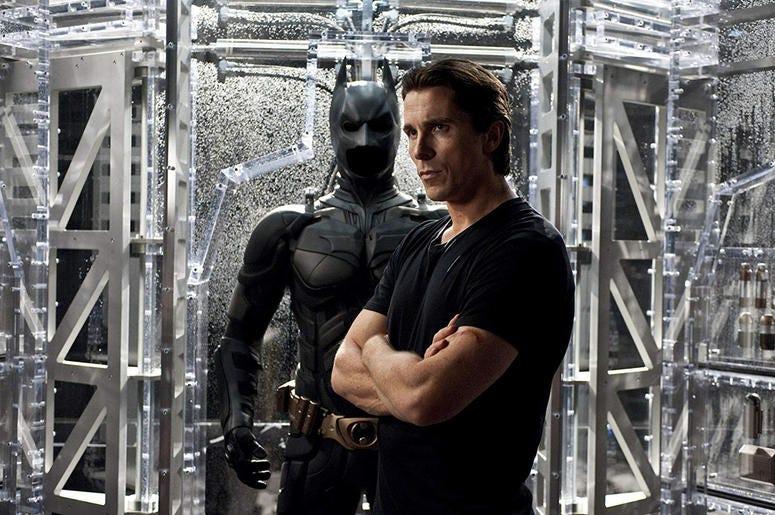 "Christian Bale as Bruce Wayne/Batman in ""The Dark Knight Rises"" (Photo credit: Ron Phillips/Warner Bros)"