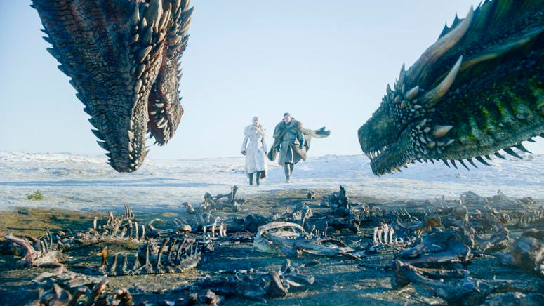 """This image released by HBO shows Emilia Clarke, left, and Kit Harington in a scene from the final episode of """"Game of Thrones."""" On Tuesday, July 16, 2019, the program was nominated for an Emmy Award for outstanding drama series. (HBO via AP)"""
