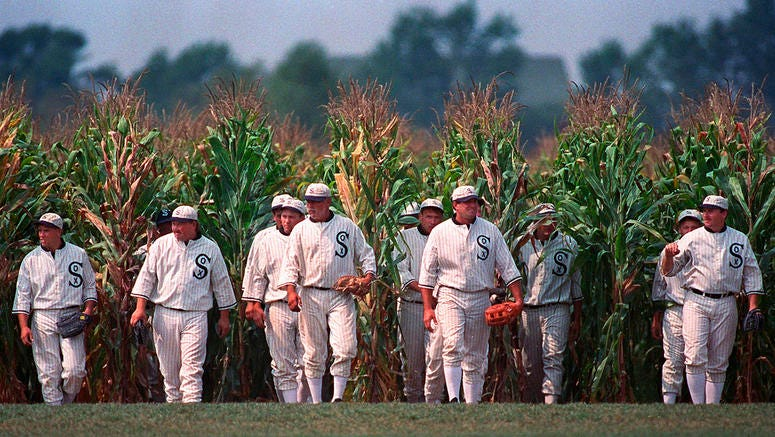 "In this July 22, 1977, file photo, people portraying ghost players emerge from a cornfield as they reenact a scene from the movie ""Field of Dreams"" at the movie site in Dyersville, Iowa. The Chicago White Sox will play a game against the New York Yankees"