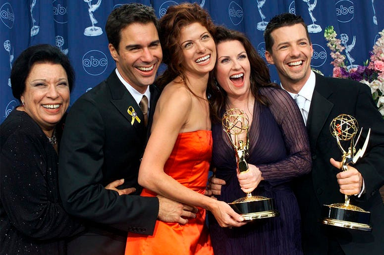 """In this Sept. 10, 2000, file photo, Shelley Morrison, from left, Eric McCormack, Debra Messing, Megan Mullally and Sean Hayes celebrate their awards for their work in """"Will & Grace"""" at the 52nd annual Primetime Emmy Awards in Los Angeles. (AP Photo/Kevork"""