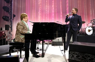 Sir Elton John and Taron Egerton perform onstage during the 27th annual Elton John AIDS Foundation Academy Awards