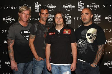 Jon Wysocki, Johnny April, Mike Mushok and Aaron Lewis of Staind poses at an event marking the release of 'The Illusion of Progress' at the Hard Rock Cafe in Times Square on August 19, 2008 in New York City