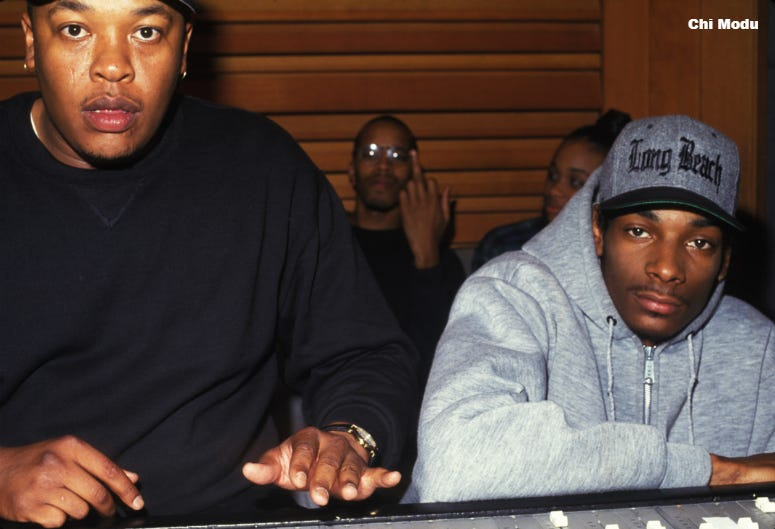 Snoop Doggy Dogg in the studio with Dr. Dre and Warren G (in back). Snoop was recording his multi-platinum album, 'Doggy Style' in Los Angeles in 1993. This photo is from the Defining Years of Hip-Hop 1990-2000 (Photo by Chi Modu/diverseimages)