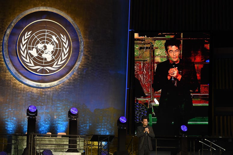 Artist Chris Jordan giving a speech at the UN