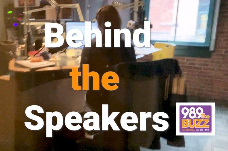 Behind the Speakers