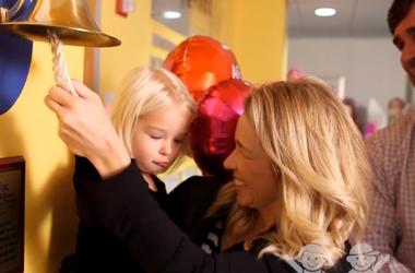 Jenn Hobby and Reese ring the bell
