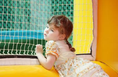 Kid in Bouncy House