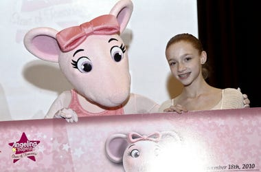 Angelina Ballerina and first national scholarship recipient Catherine Hurlin appear at the First Angelina Ballerina Stars of Tomorrow and Dizzy Feet Foundation National Dance Scholarship at Kips Bay Boys & Girls Club on November 18, 2010 in New York City.