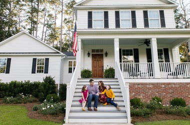 picture of family outside sitting on steps of house