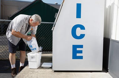 Man filling cooler with ice
