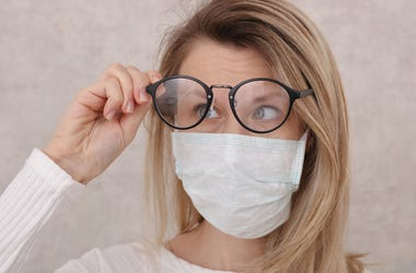 Woman wearing face mask & glasses fogging up