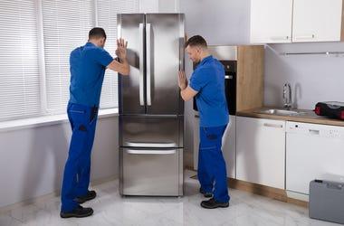 two men moving appliances