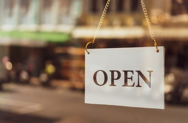 Picture of an OPEN sign at a business