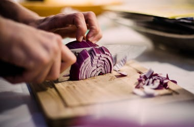 Onion being chopped on cutting board